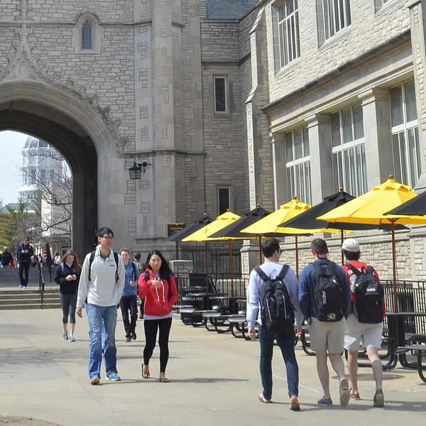 Students stroll past Memorial Union on the Mizzou campus.