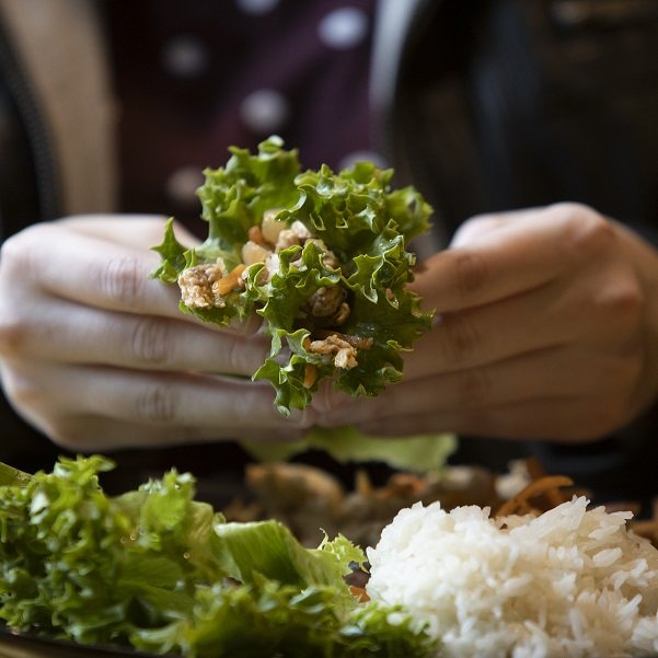 Student eating a lettuce wrap from Sabai