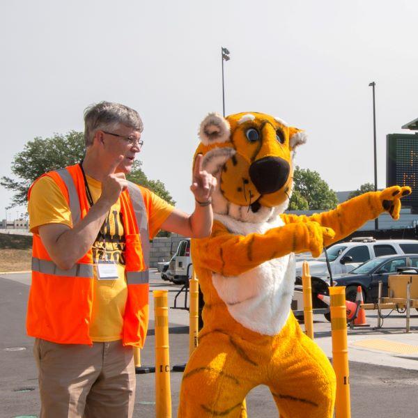 Mizzou mascot Truman helps direct traffic